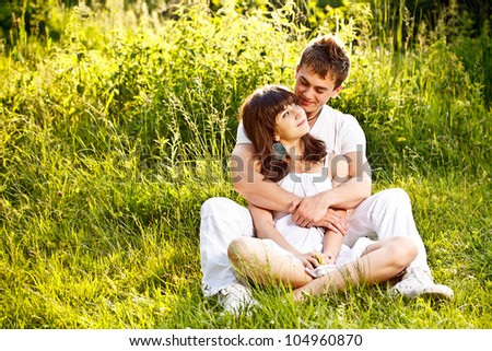 Young couple in a summer field - stock photo