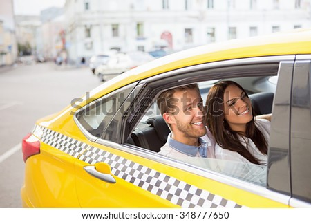 Young couple in a taxi - stock photo