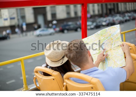 Young couple in a tour bus - stock photo