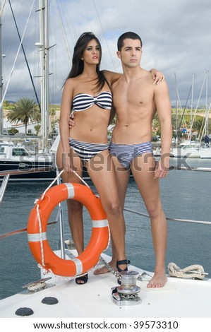 young couple in a yacht - stock photo