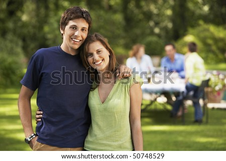 Young Couple in back yard, portrait