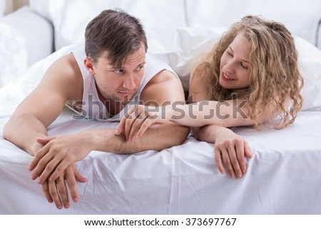 Young couple in bed at the morning