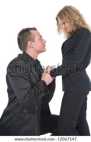 Young couple in black dress on white background