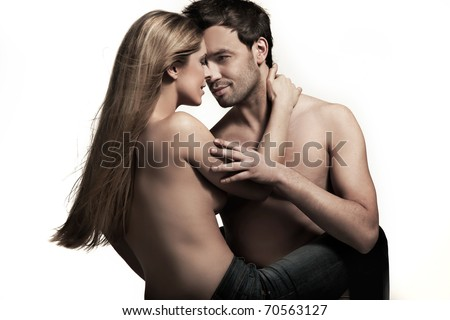 Young couple in blue jeans on white background - stock photo