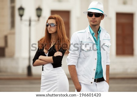 Young couple in conflict on the city street  - stock photo