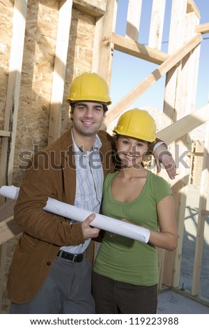 Young couple in construction site - stock photo