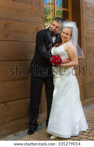 Young couple in front of an vintage house - stock photo