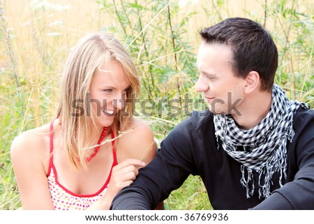 Young couple in grain field