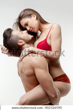 Young couple in love. A man holding a woman in a passionate embrace.