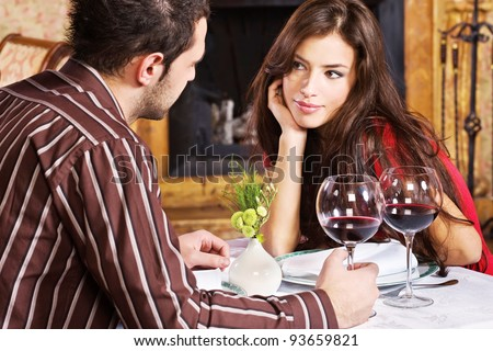 Young couple in love and red wine