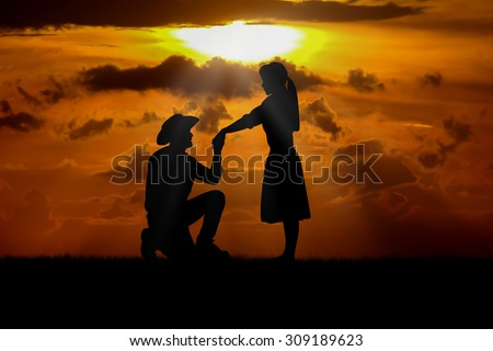 Young couple in love at   beautiful sunset.