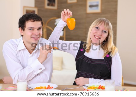 young couple in love at home eating together and having fun