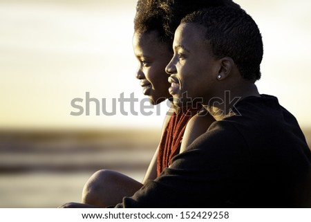 young couple in love at sunset - stock photo