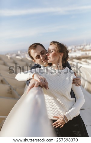 Young couple in love at the Metropol Parasol Seville, Spain.