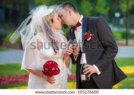 Young couple in love Celebration in garden - stock photo