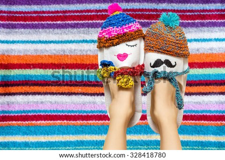 Young couple in love concept. Funny woman legs in slippers over colorful vibrant background - stock photo