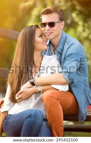 Young couple in love enjoy in the park - stock photo