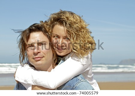Young couple in love enjoying eachother at the beach - stock photo