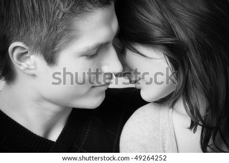 young couple in love, face to face in black and white