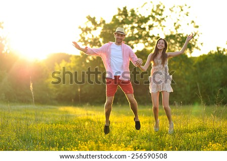 young couple in love having fun and enjoying the beautiful nature