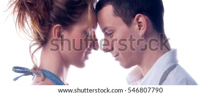 Young couple in love hugging and touching isolated on white background.