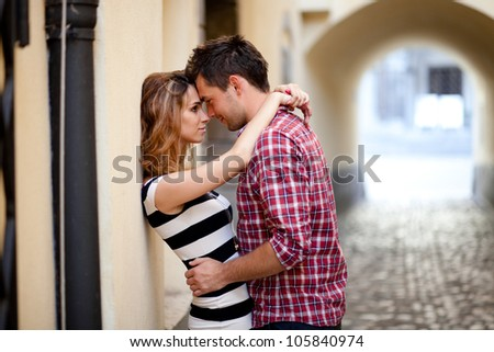 Young couple in love, hugging in the old part of town
