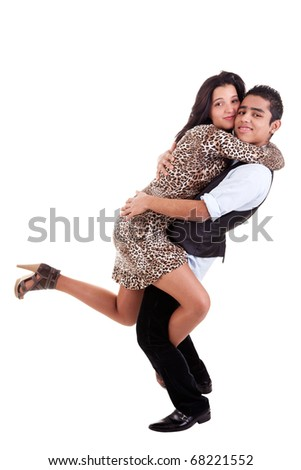 Young couple in love, hugging, man holding his beloved, isolated on white, studio shot - stock photo