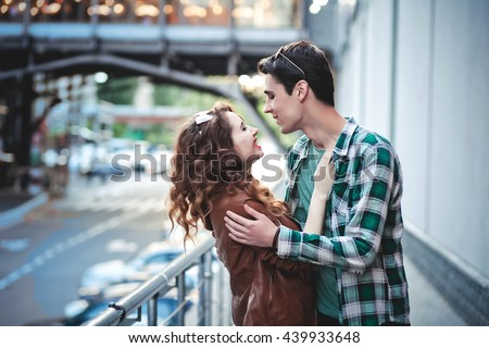 Young couple in love, hugging on the street.  - stock photo
