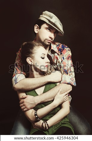 Young couple in love hugging. Studio portrait