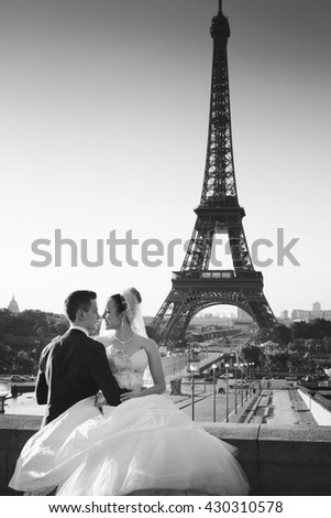 young couple in love in paris on their wedding day