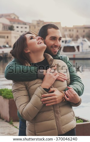 Young couple in love in the small italian city, selective focus