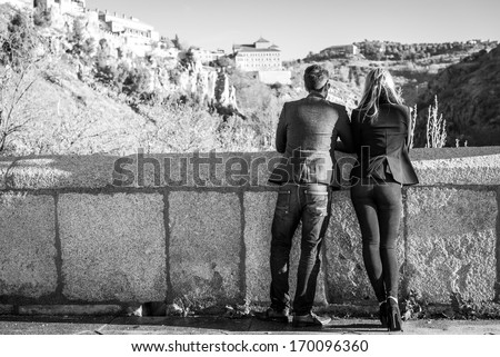 Young couple in love in the street.  Black and white photography - stock photo