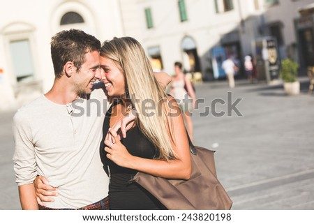 Young Couple in Love meeting and Flirting in Town Square - stock photo