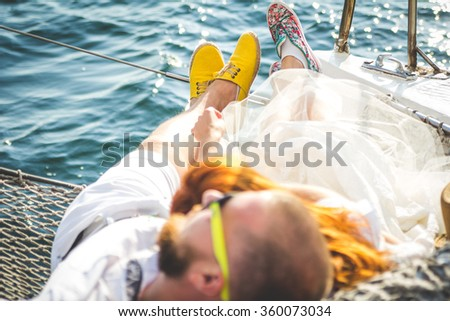 Young couple in love on sail boat - stock photo