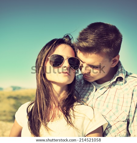 Young couple in love outdoor. Photo with instagram style filters - stock photo