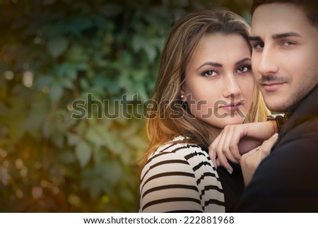 Young couple in love outdoor portrait - Romantic happy couple portrait - stock photo