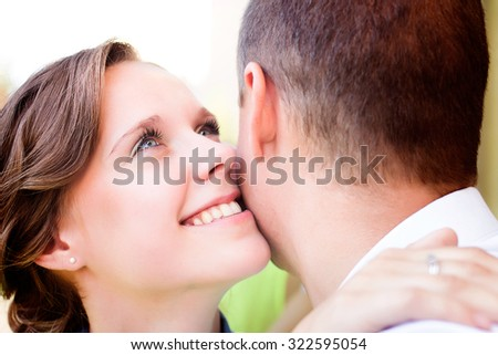 Young couple in love outdoor. They kiss and hug each other.