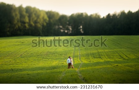 Young couple in love outdoor. Tilt-shift lens. - stock photo