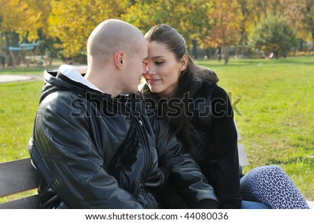 Young couple in love outdoors - intimate moments