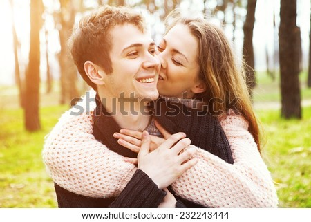 young couple in love outdoors on a sunny day - stock photo