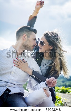 Young couple in love outside  - stock photo