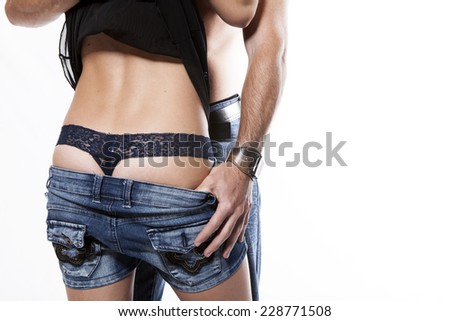 Young couple in love pulling pants