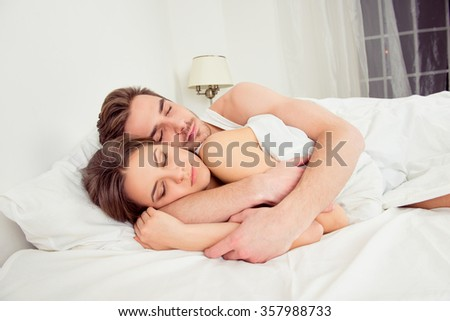 Young couple in love sleeping in  the bedroom