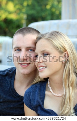 Young Couple In Love Smiling and Happy Hugging Boyfriend and Girlfriend Engaged Professional Photography of Caucasian Couple Wearing Blue Shirt - stock photo
