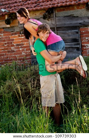 young couple in love smiling and having fun in summer outdoor