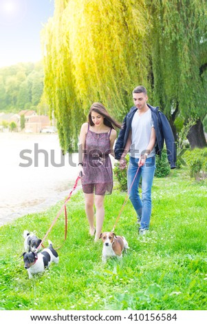 Young couple in love,walking and enjoy in park with his dogs,colored photo