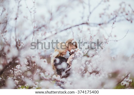 young couple in love walking in nature - stock photo