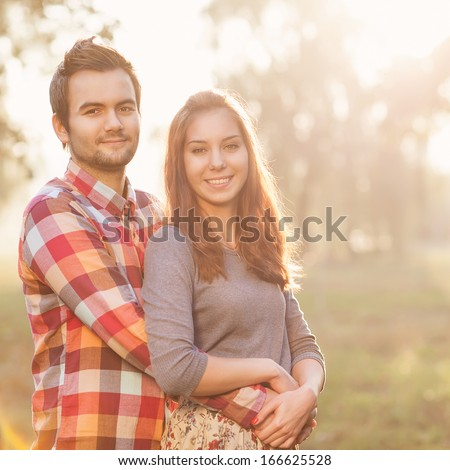 Young couple in love walking in the park - stock photo