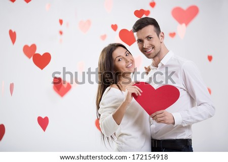 Young couple in love with hearts - stock photo