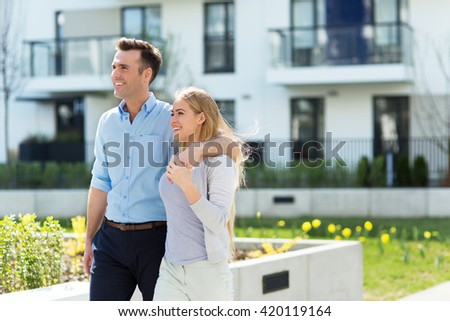 Young couple in modern residential area  - stock photo